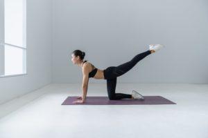 model practising meditation and yoga